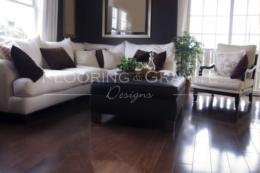 living room with furniture and dark wood floors - louisville flooring, granite and glass specialists